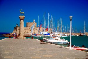 Statue of stags on columns at a harbor, Rhodes, Greece